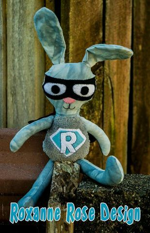 Superhero rabbit. Hand sewn features. Calico cotton, minky belly and wool blend felt.  Made in new zealand