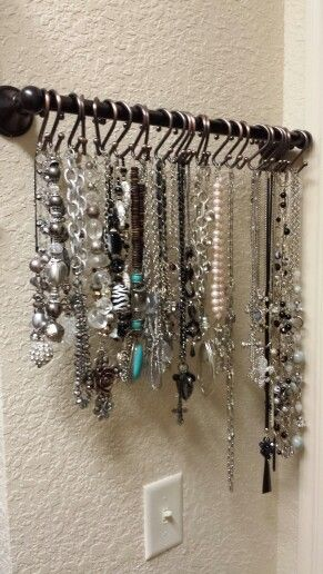 My own Pinterest project at my new house!  I needed another place to hang necklaces and I only had a small spot. I took a towel rack and cut it off and then used shower curtain hangers.  Great way to organize jewelry!