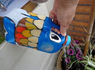 Gieter van een melkpak (recycle)