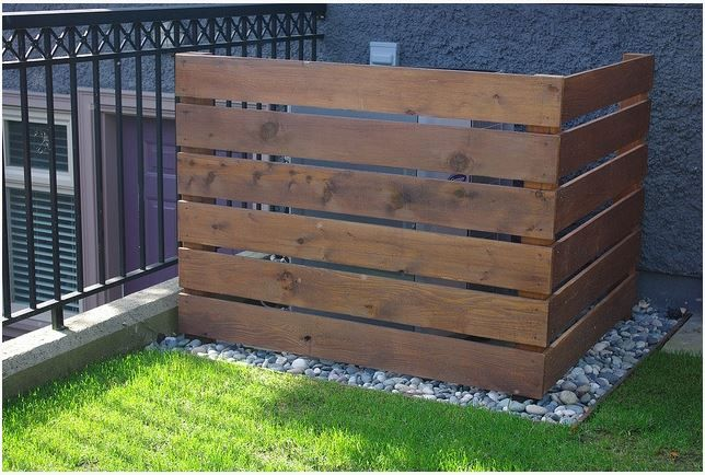 Build a wooden cover for the air conditioner outside, then maybe hang plants off of crate?