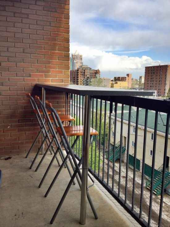Make an easy bar for your balcony out of a piece of countertop and table legs.