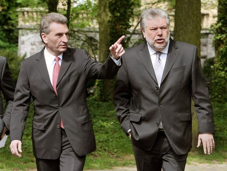 """Günther Oettinger (left), governor of Baden-Württemburg, and Kurt Beck (right), governor of Rhineland-Palatinate: Beck says he has """"the most considerable doubts as to whether"""" the Jehovah's Witness group """"could be defined as a religious community that is in keeping with Germany's constitution."""""""