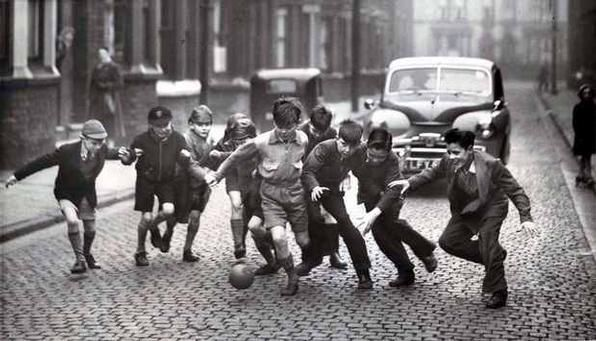 Children play football in a street in Everton 21 January 1956 #amf