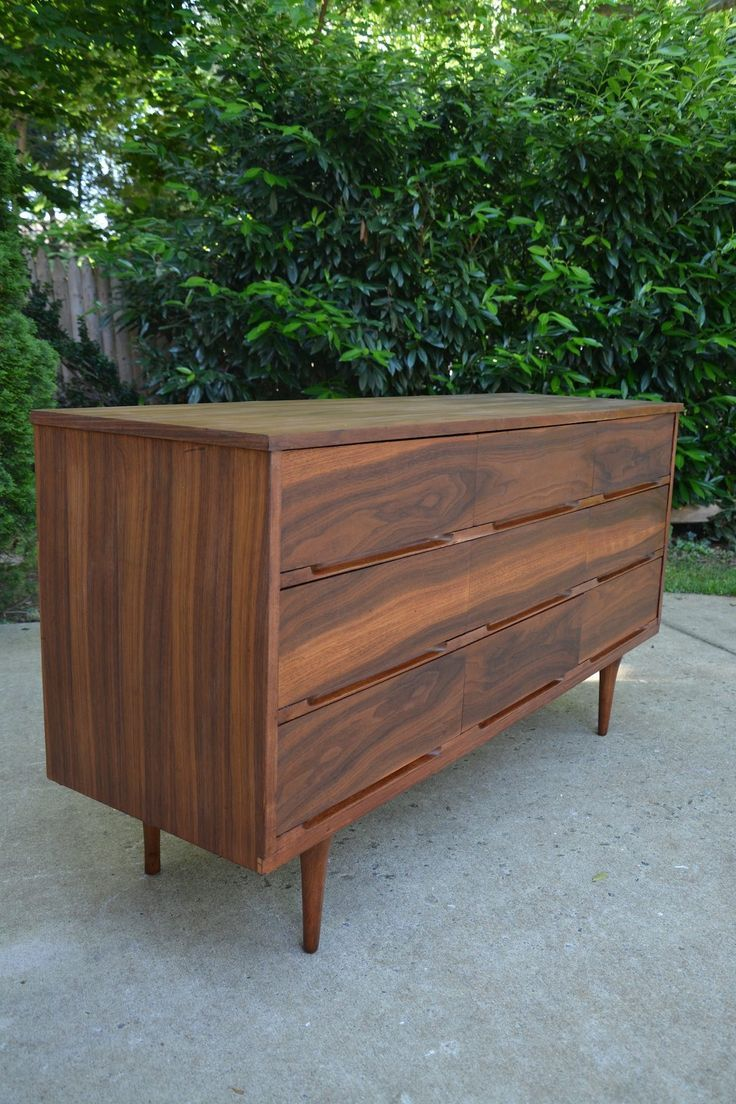 This mid-century modern dresser got a makeover but not without a few hiccups along the way. See how to strip and refinish this mid-century modern dresser! - Thrift Diving