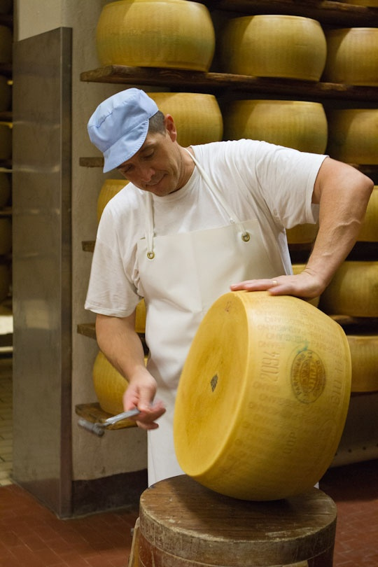 Parmigiano rests in a simple, quiet room for many months. The cheesemaker knows the wheel is ready with a simple sound test using a small hammer.