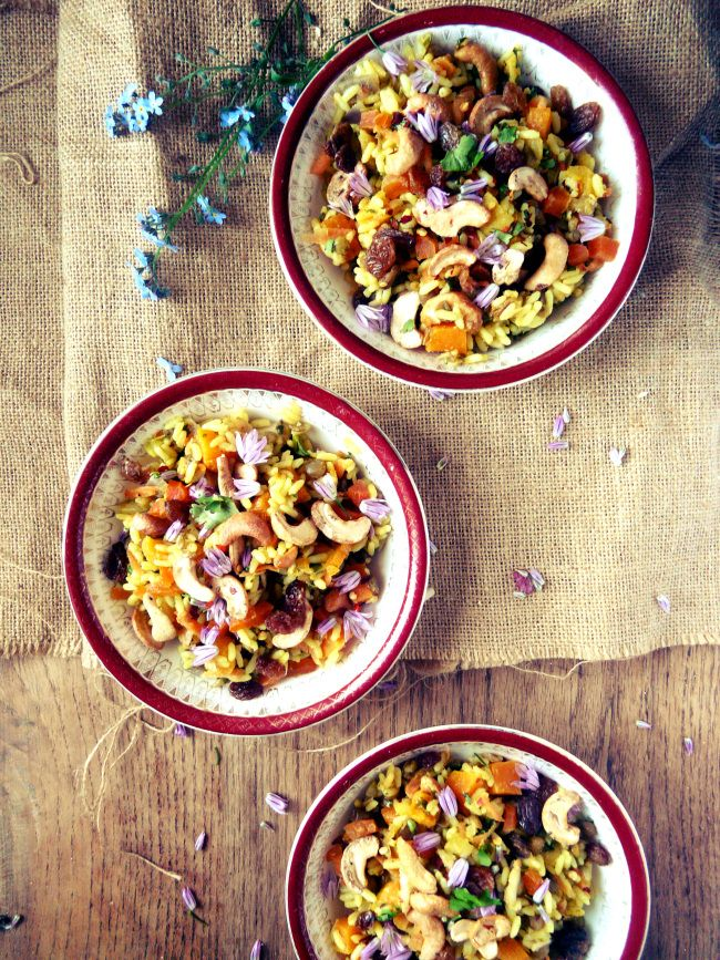 Butternut Squash, cashew and apricot pilaf with chive flowers - from In Vegetables We Trust