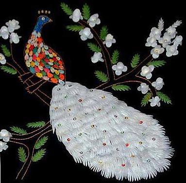 Παγώνι εντυπωσιακό,δημιουργημένο με κουκούλια μεταξοσκώληκα.!! Κουκουλάρικα κάδρα, γίνονται  απο γυναίκες του Συνεταιρισμού Γυναικών Κύμης Ευβοίας !Φωτό: Γιάννης Τούντας