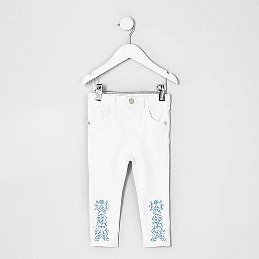 White denim Super skinny fit Embroidered hem detail Snap button fastening Five belt loops Adjustable waist Five pocket detail