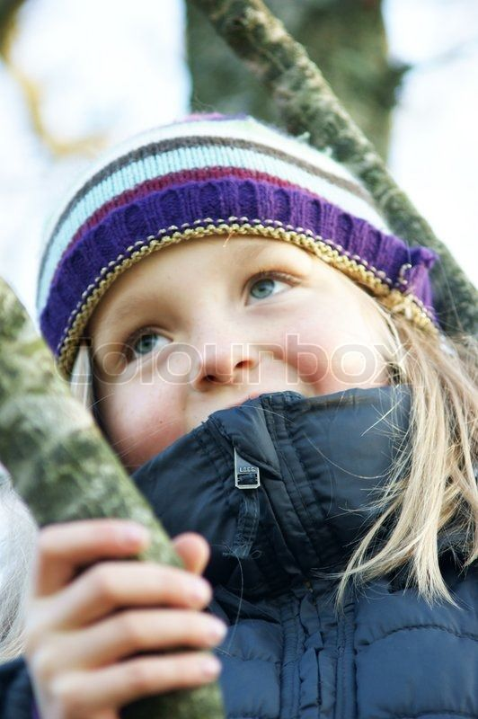 Autumn front girl climbing tree stock photo on Colourbox