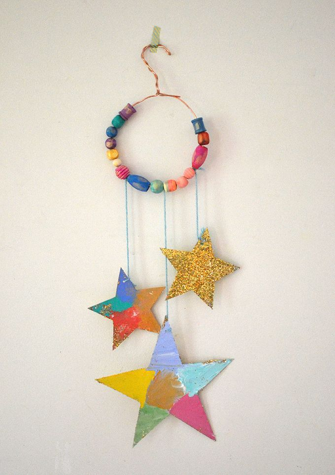 Make glitter star mobiles with cereal box cardboard, wooden beads, and wire.