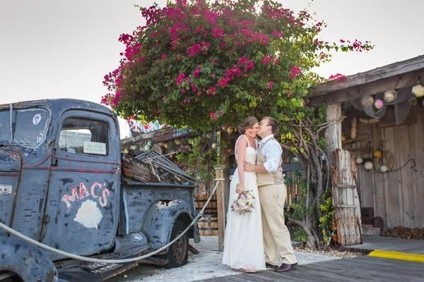 Erika and James' wedding featured on @myweddingdotcom, with  destination wedding couple in Key West in front of antique truck