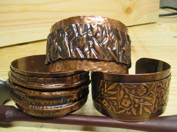 Hand forged copper cuffs. Can be purchased at Gestures.