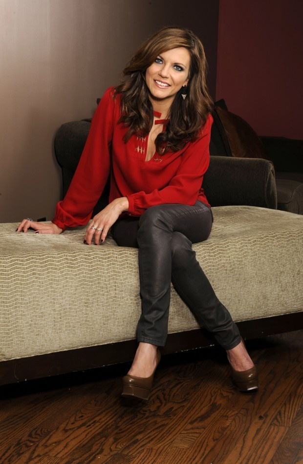 Martina McBride, red shirt , dark jeans brown shoes. I love it