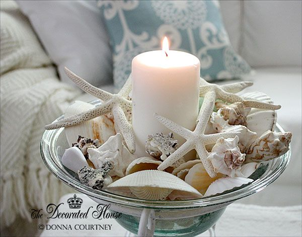 Bringing the Ocean Home. A candle and a few pretty shells.  by The Decorated House