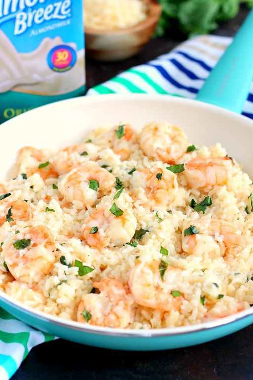 This Parmesan Basil Shrimp and Rice is packed with tender shrimp and fluffy white rice, enveloped with a Parmesan and basil cream sauce. It's easy to make and ready in less than 20 minutes. If you're looking for a new dish for dinner, then this is it!