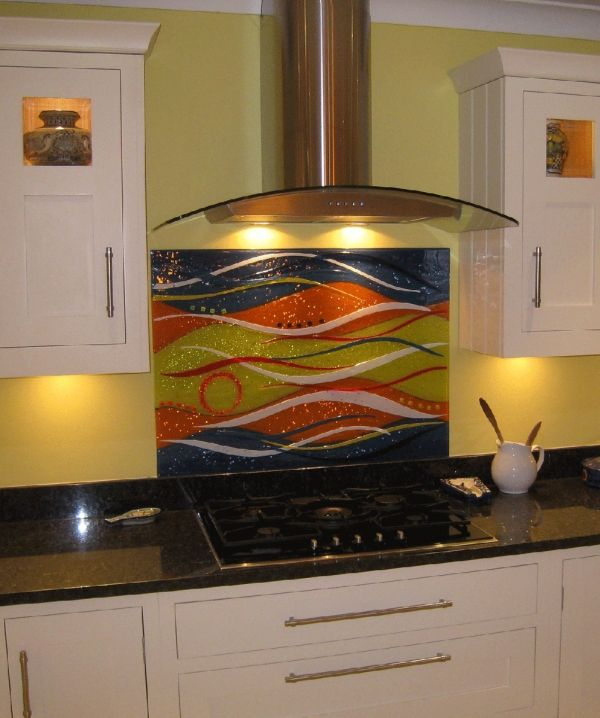 This vibrant and multicoloured Wave design is part of one of our client's kitchen splashbacks in Warwickshire. Sitting in place behind the kitchen stove, it matches both the wallpaper and the counter-top through its use of many hues. With the light illuminating it, it is an obvious centrepiece and helps bring out the colour in the room around it.