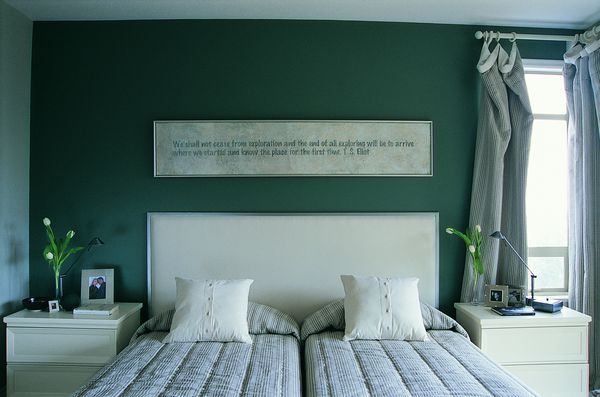 Bedroom with green accent wall.