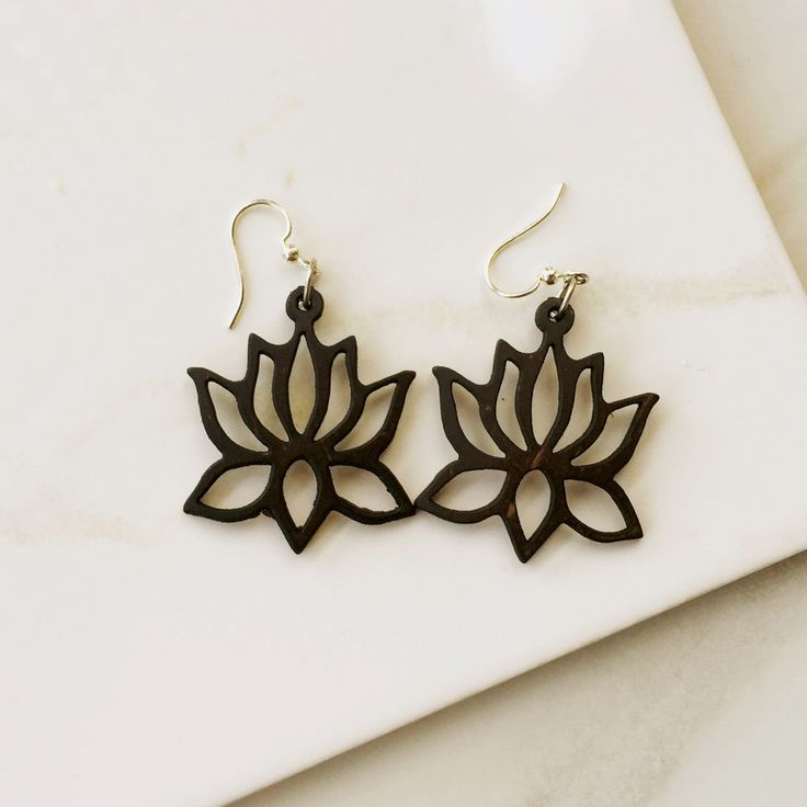 These lotus earrings are made with recycled coconut shells and are a yoga lovers must have. Super light weight and unique. - Color: Dark brown (almost black) - Size: 1.15 inch wide and 1.5 inches long