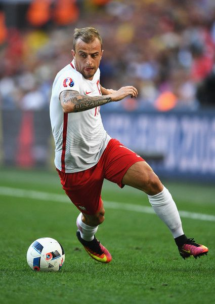 Kamil Grosicki of Poland runs with the ball during the UEFA EURO 2016 Group C match between Ukraine and Poland at Stade Velodrome on June 21, 2016 in Marseille, France.