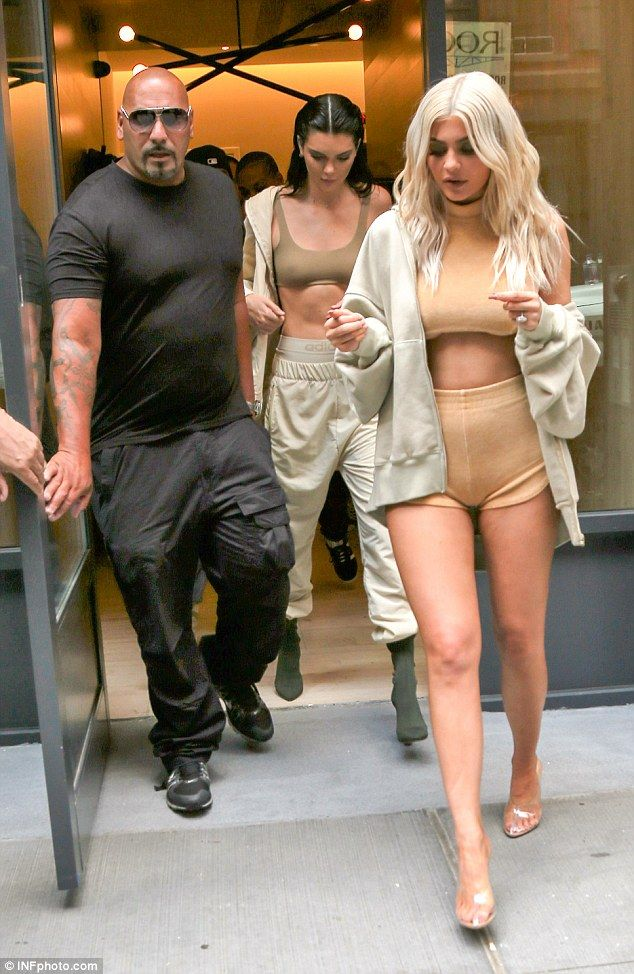 Skimpy: Kylie flashed some underboob in the skintight top and tiny shorts as she headed to the Yeezy show with sister Kendall Jenner, who wore an olive sports bra