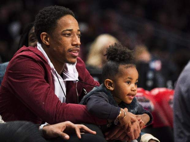 Mark Blinch/CPRaptors guard DeMar DeRozan and his daughter watch the NBA all-star skills competition Saturday.