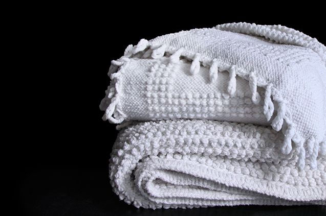 our temoayan blankets in 'nudos' and 'persiano'. nubby goodness.