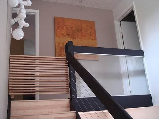 A homemade top of the stair baby gate by Blue Ant Studio