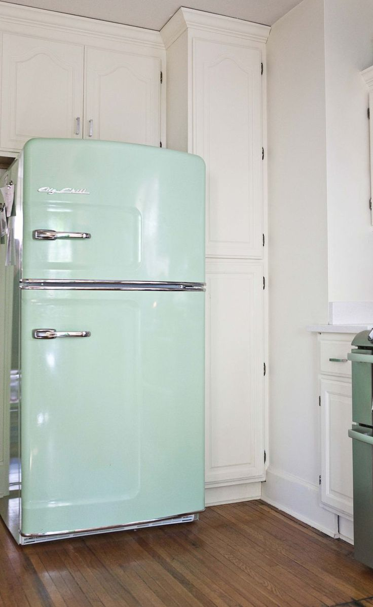 "@Christine Thelen this fridge is called ""Big Chill"" Fridge :) and this kitchen is adorable. love the unfinished wood shelves for glass and serving ware"
