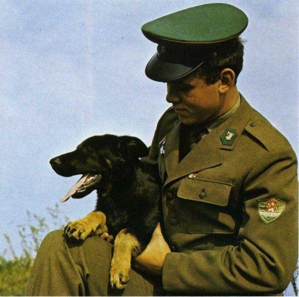 A serviceman of the Czechoslovak Socialist Republic Border Guard (Pohraniční Stráž) with his dog.