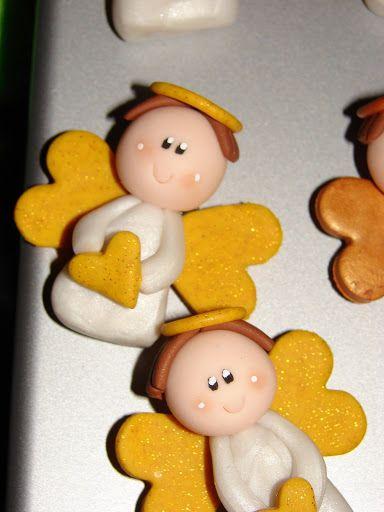"""e per finire ecco le bomboniere per una prima comunione....   dei simpatici angioletti """"magnetici """""""