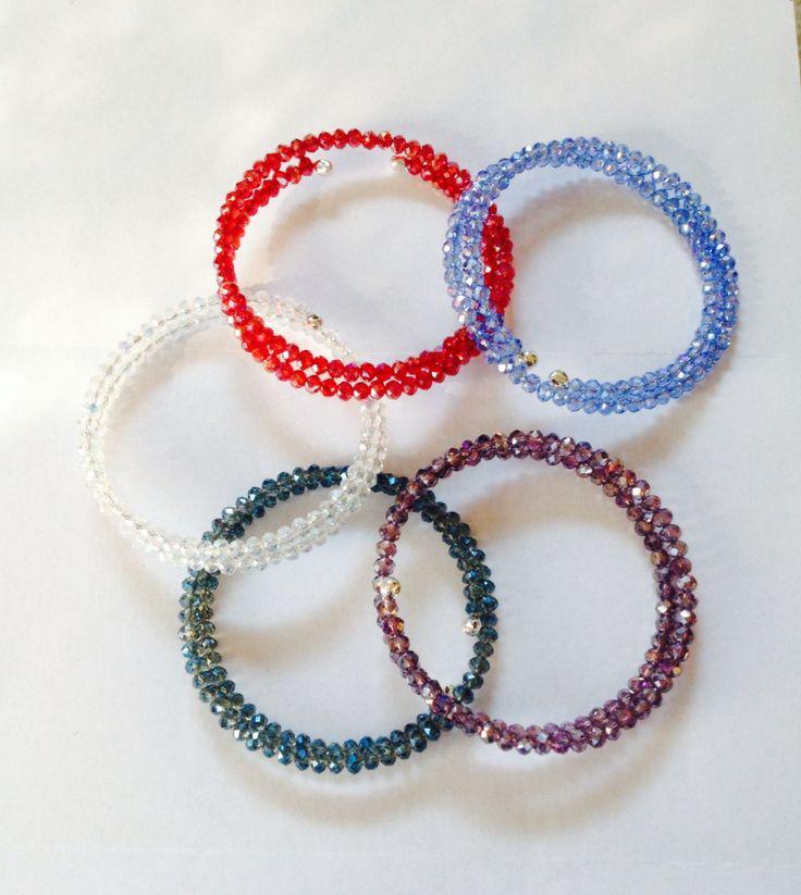 Bracciali con cristalli e filo armonico.  Memory wire and crystals bracelets.