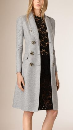 A tailored double-breasted coat in cashmere. The design is unlined and tapered at the waist for a close fit.