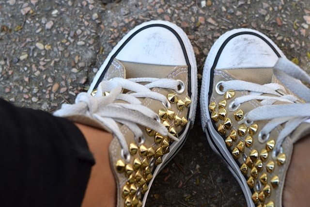 gold-spiked tan converse