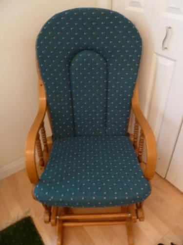 Rocking chair and ottoman with green upholstery. $50