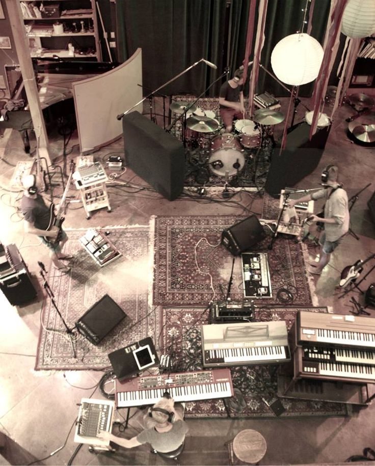 "Rugs, high ceilings, drums, keyboards, and a collection of baffles. good good things. ""Oh crap how do i do this? [watches youtube tutorial]"""