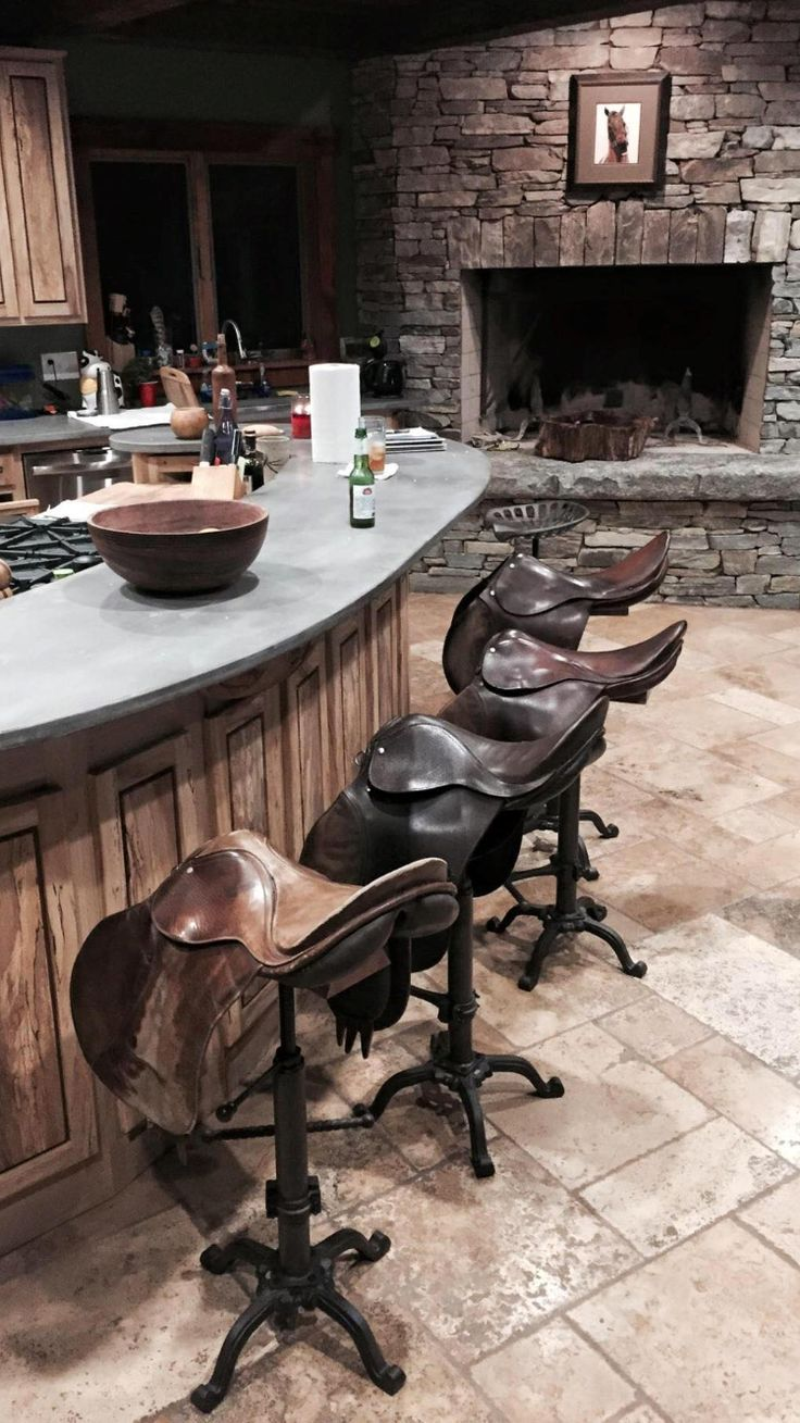Vintage used saddles for bar stools! StyleMyRide.net #equestrian