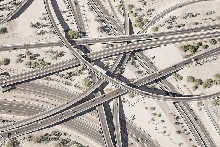 Photographer Peter Andrew likens the interstate to a cardiovascular system, where cars are blood cells and roads are arteries.