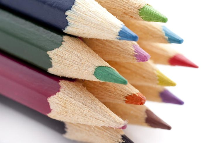 Free Stock Photo: Closeup of the tips of a selection of colouring pencils over white background - By freeimageslive contributor: gratuit