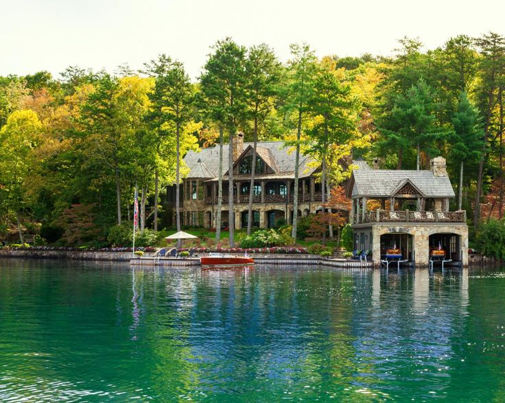 Stone columns decorate the cabin's stately exterior, which houses seven bedrooms and six bathrooms. The property also includes a two-story boathouse and a large dock.