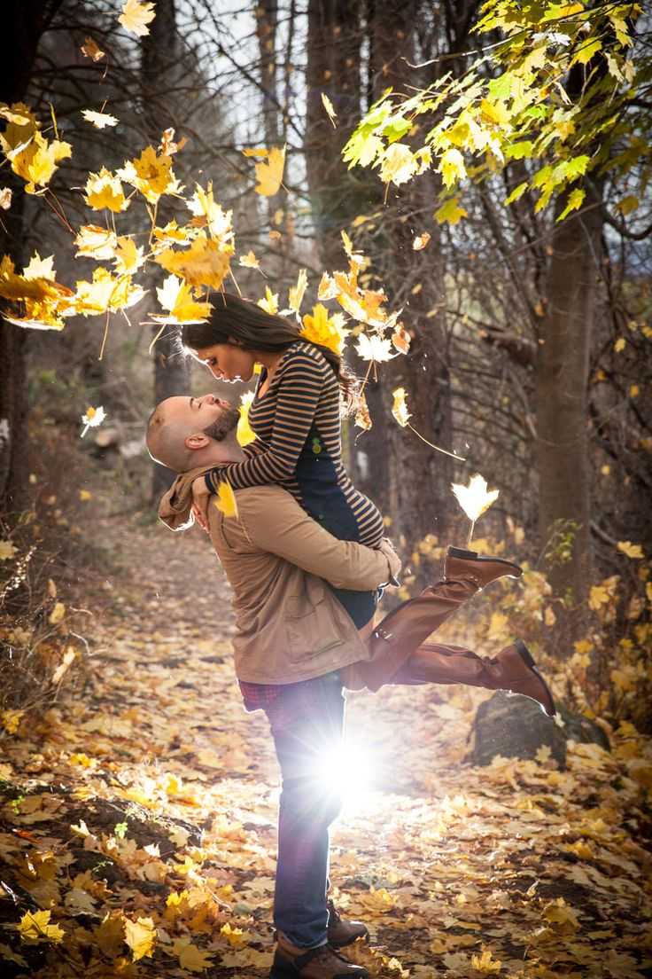 Gorgeous sun coming through fall engagement photo