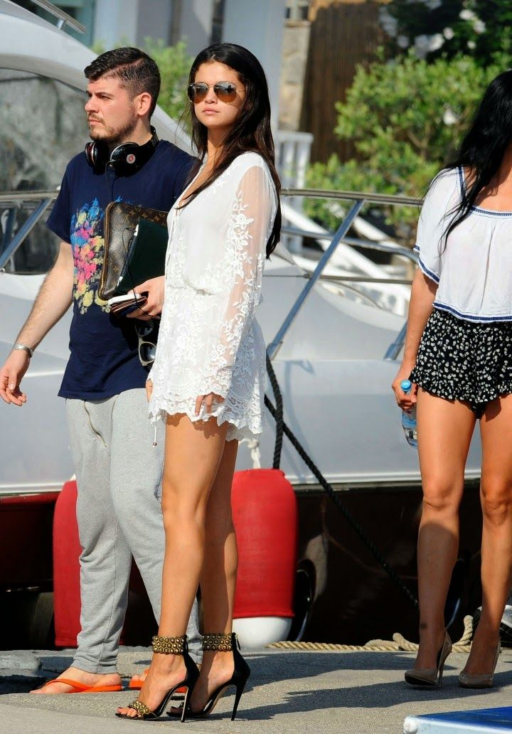 Selena Gomez boards Italian yacht in a lace mini dress and studded stilettos