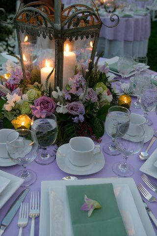Indoor and outdoor entertaining: Lantern centerpiece, candles, purples