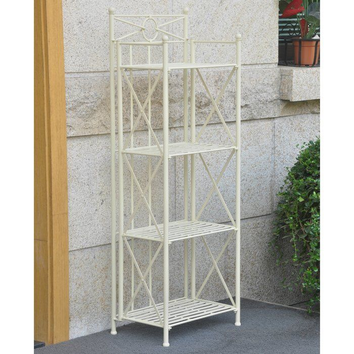 Give your home a contemporary and modern update with this new St. Lucia bakers rack by International Caravan Home Furnishings that combines elegance and class for an engaging decor element. The antique white iron frame has a modern and decorative touch that softens the overall appearance. The four shelves offer extra space for books and accent pieces, or candles and decorations for the hall or entryway. You can also use this baker's rack out on your patio to display potted plants or store...