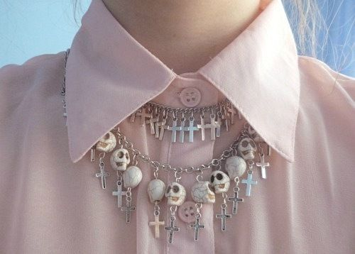 pastel pink collared top and skull neckless
