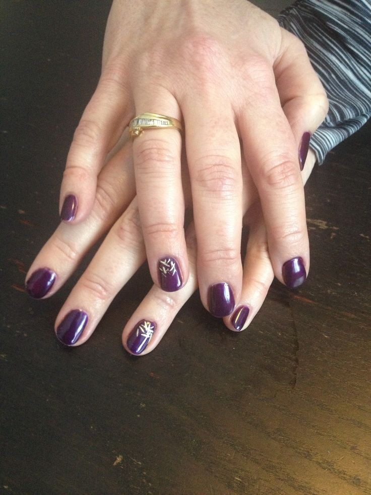 Purple shellac with gold nail art accent nails