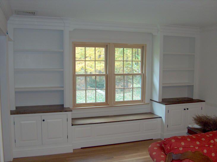 livingroom built ins around window with glass doors - Google Search