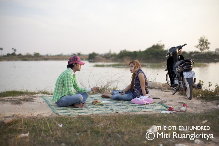 A young couple enjoy a picnic besides Plov Lek 60 Road on the untouched outskirts of Siem Reap, one of Cambodia's fastest-growing cities.(Photo by Miti Ruangkritya)