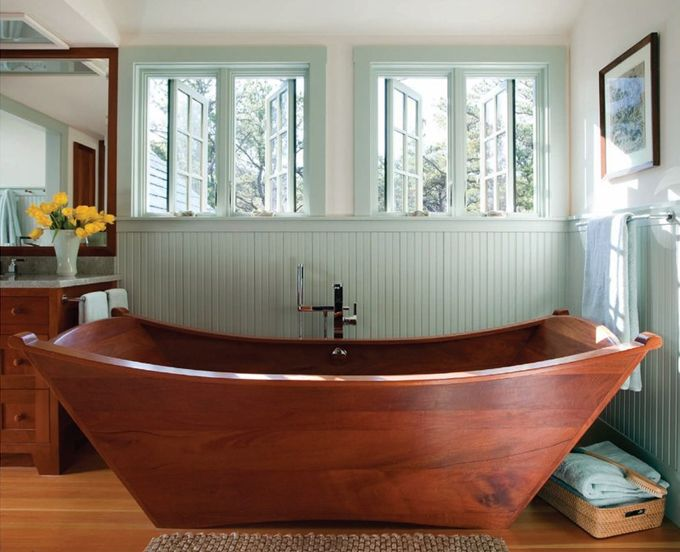 Have any of you ever seen a wooden bathtub before?! I didn't even know they existed! Inspired by the comfort of an antique armchair and the sweeping sheer of a sailboat, Bath in Wood of Maine has been crafting wooden bathtubs for three years. This particular double bathtub featured in Design New England is made from a deep-sealed Honduran mahogany. Imagine how long the water would stay warm in that! (And what fun kids would have pretending it was a boat!) Oh, and the bead-board wainscoting…