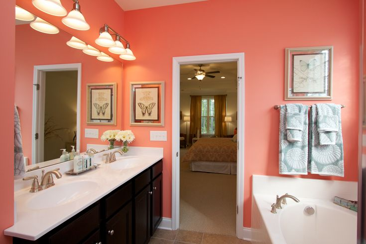 We love this bright coral colored bathroom!
