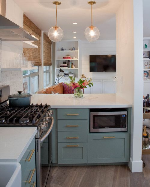 Muted green/teal bottom cabinets with gold pulls